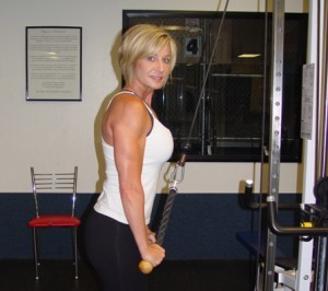 Canice Barbone demonstrates a tricep exercise at her fitness gym in La Verne.