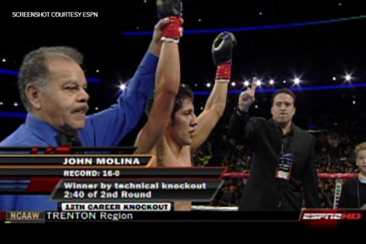 Molina wins his 16th straight bout while Miller wags a big No. 1 in approval.