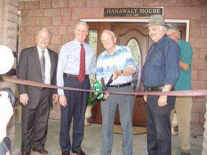 Hanawalt family representative J.Clair Hanawalt cuts the ribbon symbolizing the reopening of the Hanwalt House, once the home of W.C. Hanawalt, the University of La Verne's 5th president.