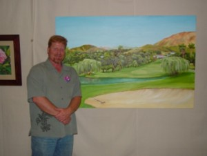 Artist Eric M. Davis stands beside his recently completed painting.