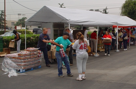 Neither rain, nor sleet, nor hail, nor lightning, could halt yesterday's food bank distribution to the community.