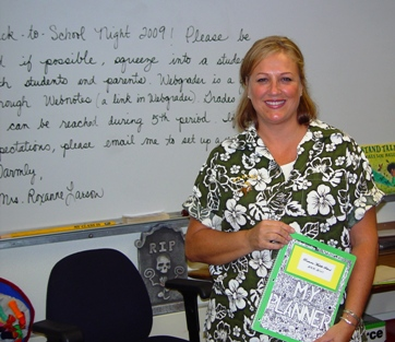 Roxanne Larson holds the student planner created by a Ramona student.