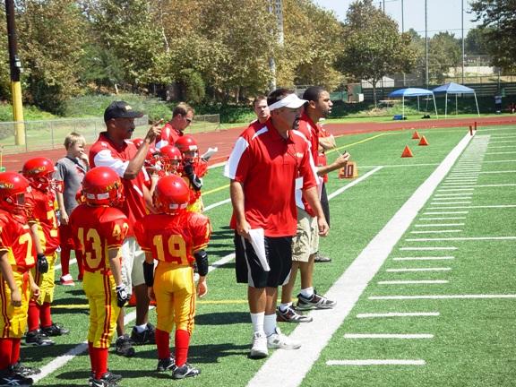 Gladiator coaching staff shouts encouragement.