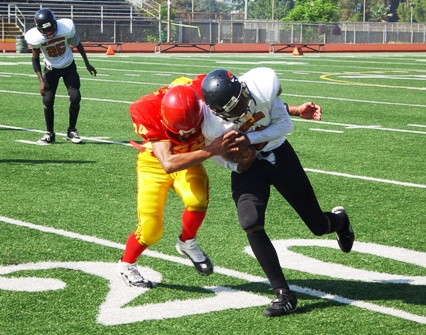 The Trojans' Dane Hollar wraps up a Chiefs running back.