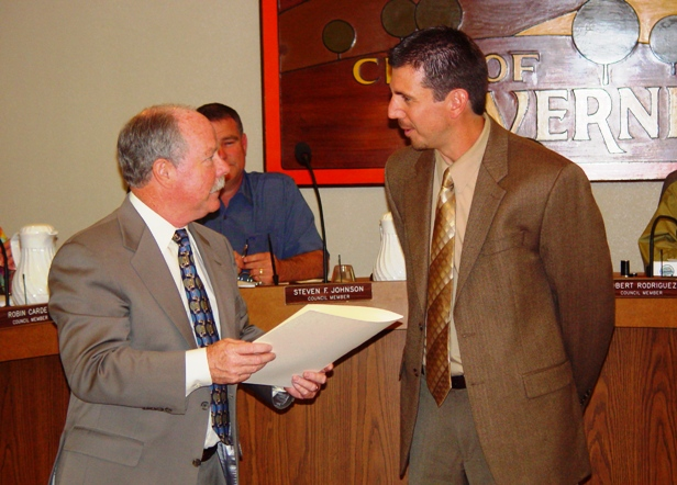 Mayor Don Kendrick, left, recognizes Sean Grycel, principal of J. Marion Roynon Elementary School, for his and his staff's efforts helping Roynon become a California Distinguished School.