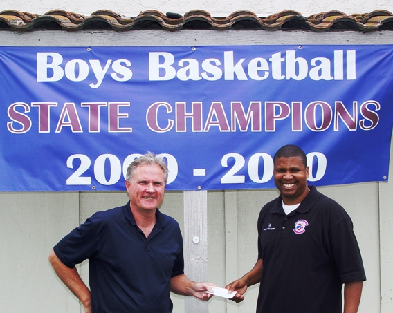 From left, Peter Bennett, publisher and editor of LaVerneOnline presents a sponsorship check to La Verne Lutheran coach Eric Cooper, who has organized a Jan. 22, 2011 basketball tournmanent at the University of La Verne featuring top basketball teams from throughout the state of California. Cooper guided the Trojans to the Divison 5 state championship this spring.