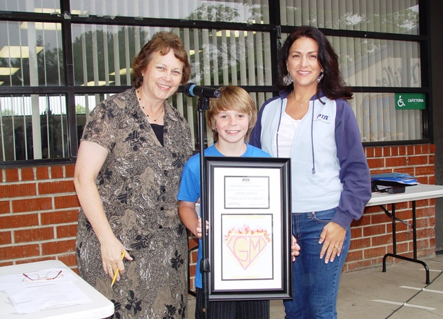 Joshua Natisch with Grace Miller Principal Deanne Spencer and PTA President Julie Harris.