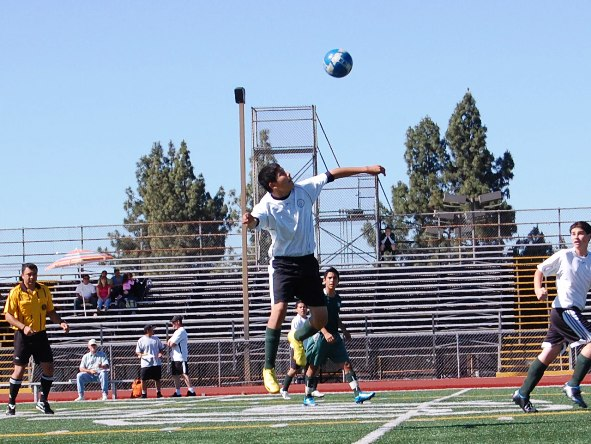 La Verne player heads the ball in midair.