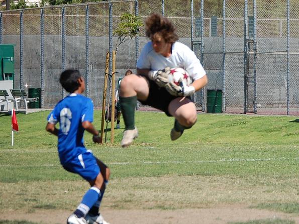 Under 14 La Verne goal keeper makes heroic save.