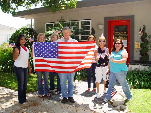 Well-wishers along Bonita show their true colors and affection for the World War II hero.