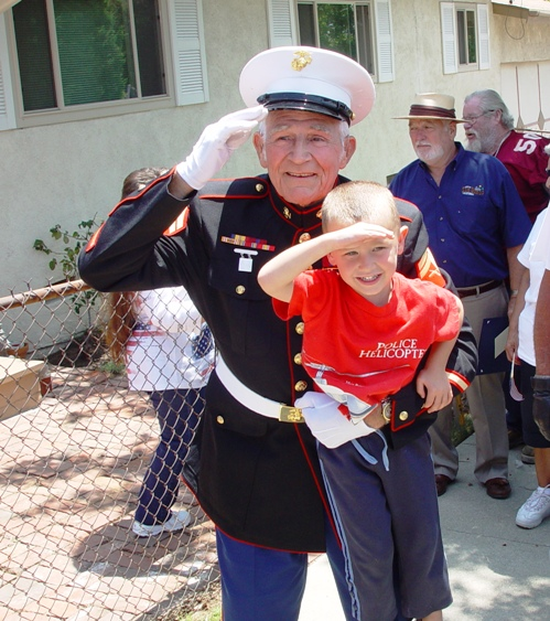 Carl Harstine and young admirer salutes his new flag.