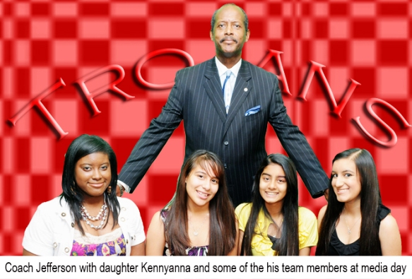 Coach Jefferson with daughter Kennyanna and some Trojan players at media day.