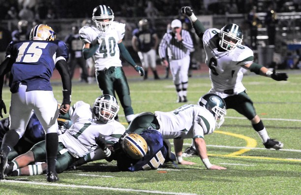 Running mates KC Huth (6), Eric Mikity (31) and Gio Johnson celebrate another defensive stop.