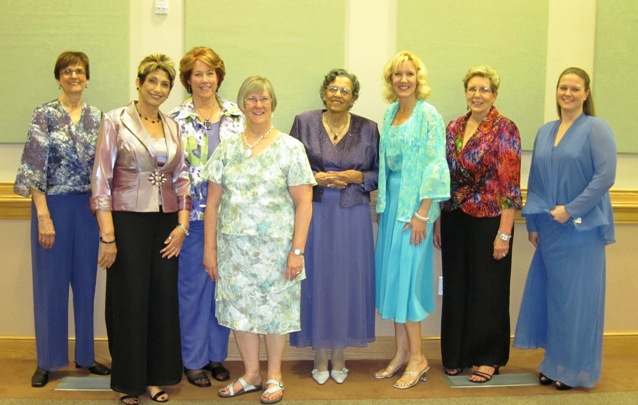 From left, AAUW models were Karen Cahill, Rhonda Goudeau, Sarah Byer, Mary Kay Ogden, Betty Jackson, Julia Wheeler, Susan Curtis, and Melody Hanawalt.