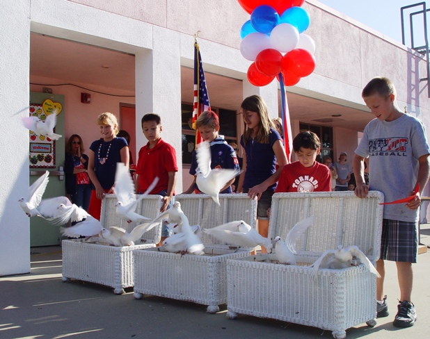 As part of the Patriot's Day celebration, Oak Mesa students released doves from captivity to fly free.