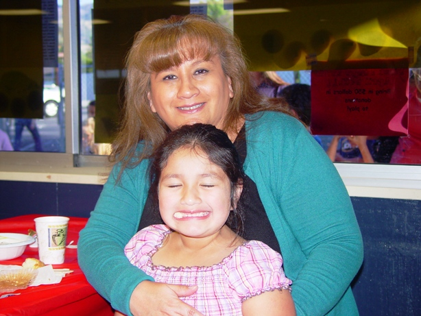 Lorraine Gallegos with her daughter Mia, who is having a little breakfast-time fun.