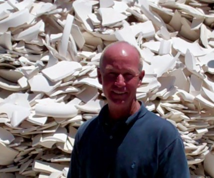 The Profit Pit: Steve Gainey stands in front of a glacier of broken pots ready to be recaptured in the plants ongoing recycling process