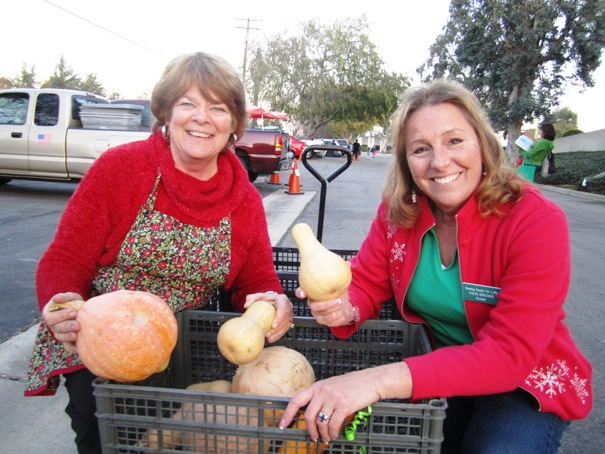 Mary Moody, left, and Vicki Brown show off some the of vegetables that came from the SSFL garden.