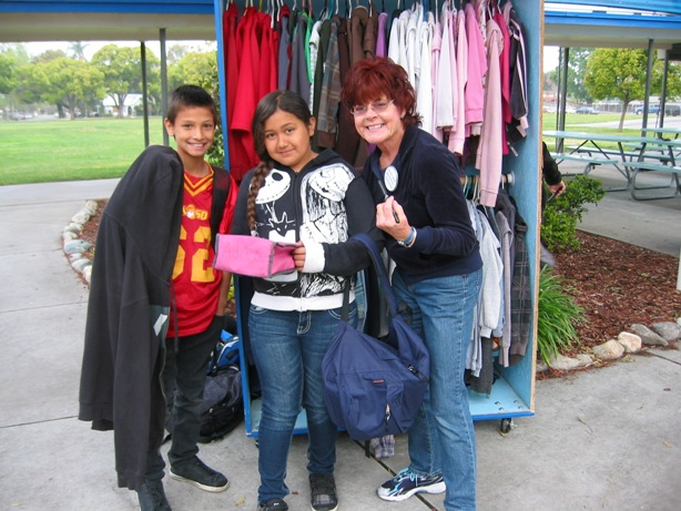 Sandee shares a Eureka (I found it) moment with two happy students, who found their belongings.