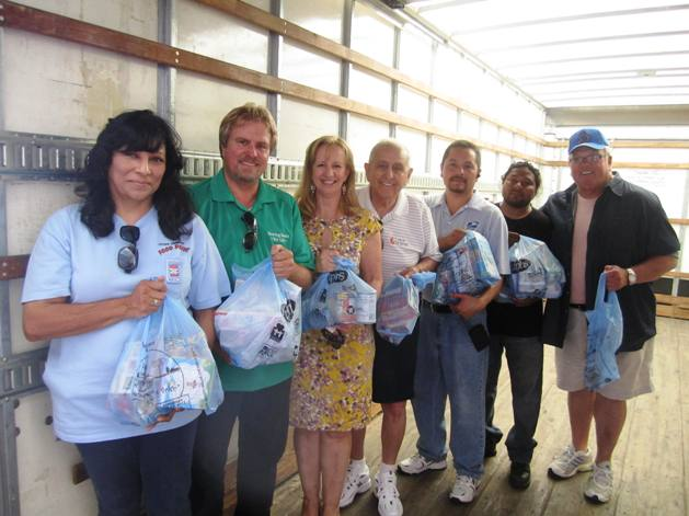 A small army of volunteers, including, from left, Linda Mazuca, Greg DeSmet, Robin Carder, Robert Rodriguez, Tony Mazuca, Jorge Montero and Chris Roberts, were on the front lines organizing the successful food drive.