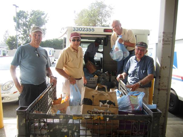 Volunteers Hal Henderson and friends from the Faith Lutheran Church of San Dimas weren't sitting at the loading docks, they were working.