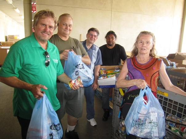 Greg DeSmet, Jim Anderson, Greg Tatsch, Jorge Montero and Melody Leader put their Saturday to good use, collecting food those in need.