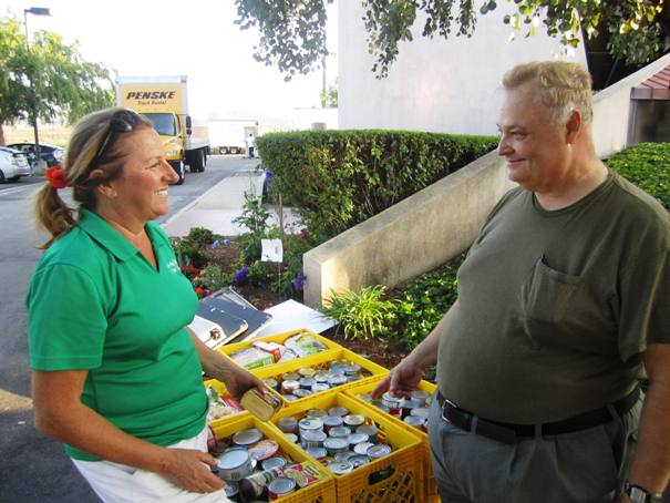 Vicki Brown and Jim Anderson, back at DPI Labs, reflect on another bountiful food-raising day.