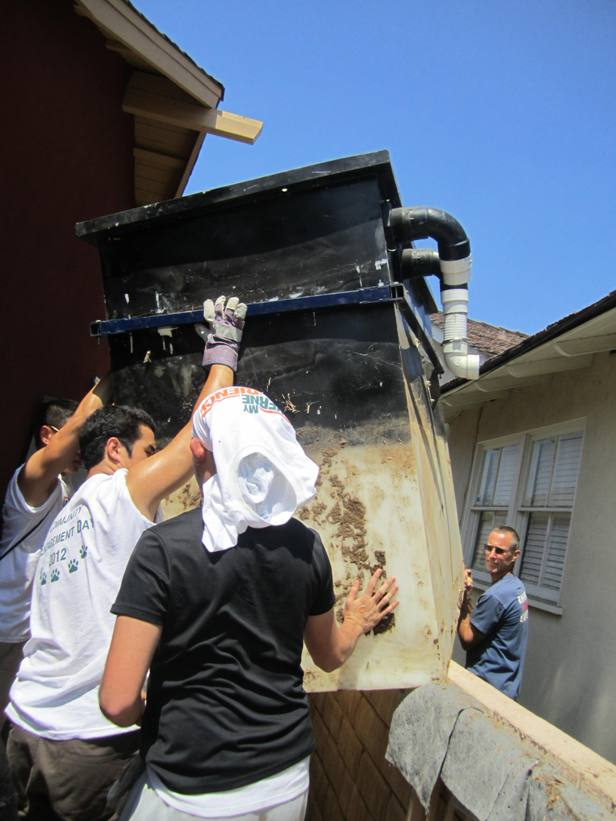 Moving large tilapia fish tank from the greenhouse in the back of a Covina home to truck trailer in frton was no easy task.