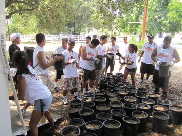 ULV students spent part of the day moving organically-treated dirt.