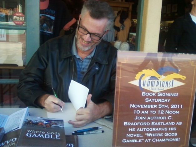 Author Brad Eastland is wagering you'll love his book Where Gods Gamble. Here he is signing a copy at Santa Anita Racing Park last fall.