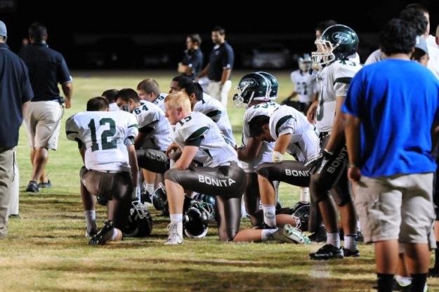 Bonita takes a knee after teammate Brandon Smith suffers an injury.