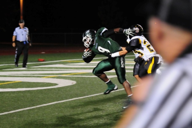 Shane Pitts drags a defender into the end zone.