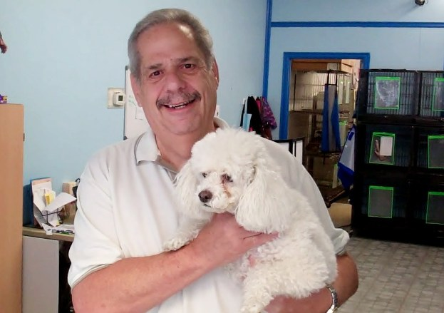 Mark Levy holds one of his canine companions.