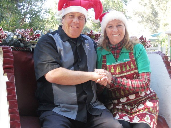 Sowing Seeds founder Vicki Brown and Pomona Mayor Elliott Rothman enjoy a sleigh ride at last year's event.