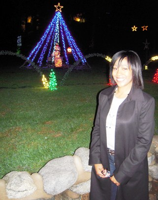 Director of Development Jane Woods takes a moment to enjoy a view of the holiday lights from the street. To view the lights, visit LeRoy Haynes Center at 233 W. Baseline Road, La Verne.