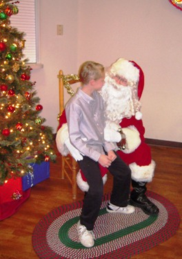 Pictured on Santa's knee is LeRoy Haynes resident Jacob, 10.