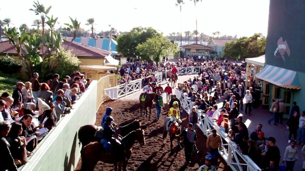 Horses prepare to pass through the tunnel for the call to the post for Santa Anita's sixth race on the opening-day card.