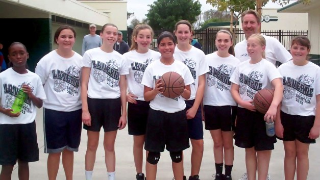 DREAM TEAM: With their unselfish passing, the Dream team looks as if it could go a long way in the upcoming playoffs. The players are, from left, Tamia, Alyssa, Kelli, Amber, Brianna, Sam, Genae, Coach Dan, Abby and Jessica.