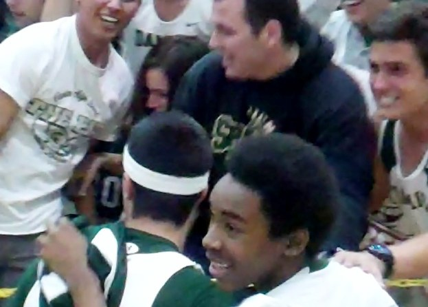 Jeremy Hemsley greets the Damien student section after he sank the winning basket at the buzzer.