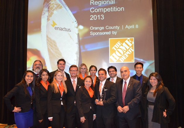 WINNING LOOK: Success always draws a crowd, as these Enactus members show.