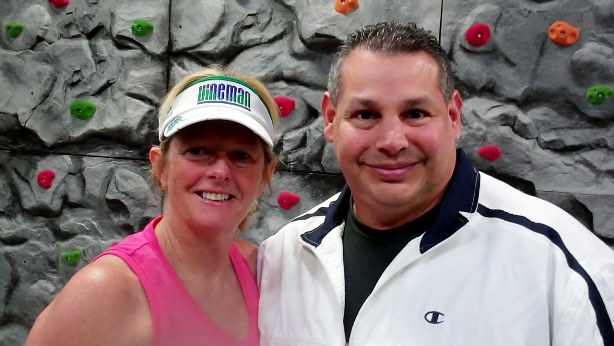A Bouldering We Go: Owner Lance McCullough and Fitness Results member Jen Schiller think the new bouldering wall at Fitness Results rocks.