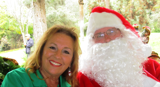 Sowing Seeds for Life Founder Vicki Brown with the jolly red and white Santa Claus man, aka James Scott.