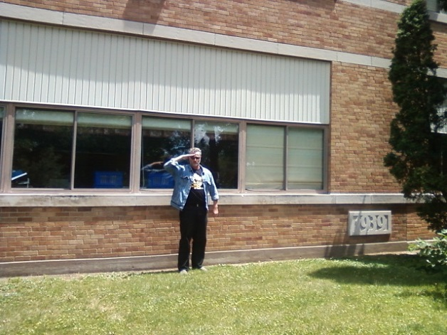 Here's the Sports Philosopher giving the Jon-Jon salute in 2012, in front of the 3rd-grade classroom in Washington, Iowa, where he was sitting when he heard the awful news about JFK on Nov. 22nd, 1963.
